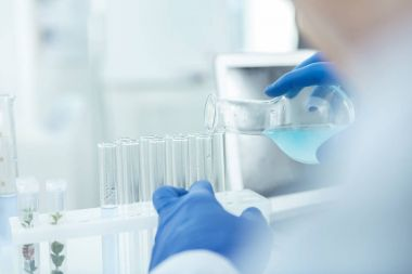 Knowledge in use. Professional male researcher conducting an experiment in a lab stock vector
