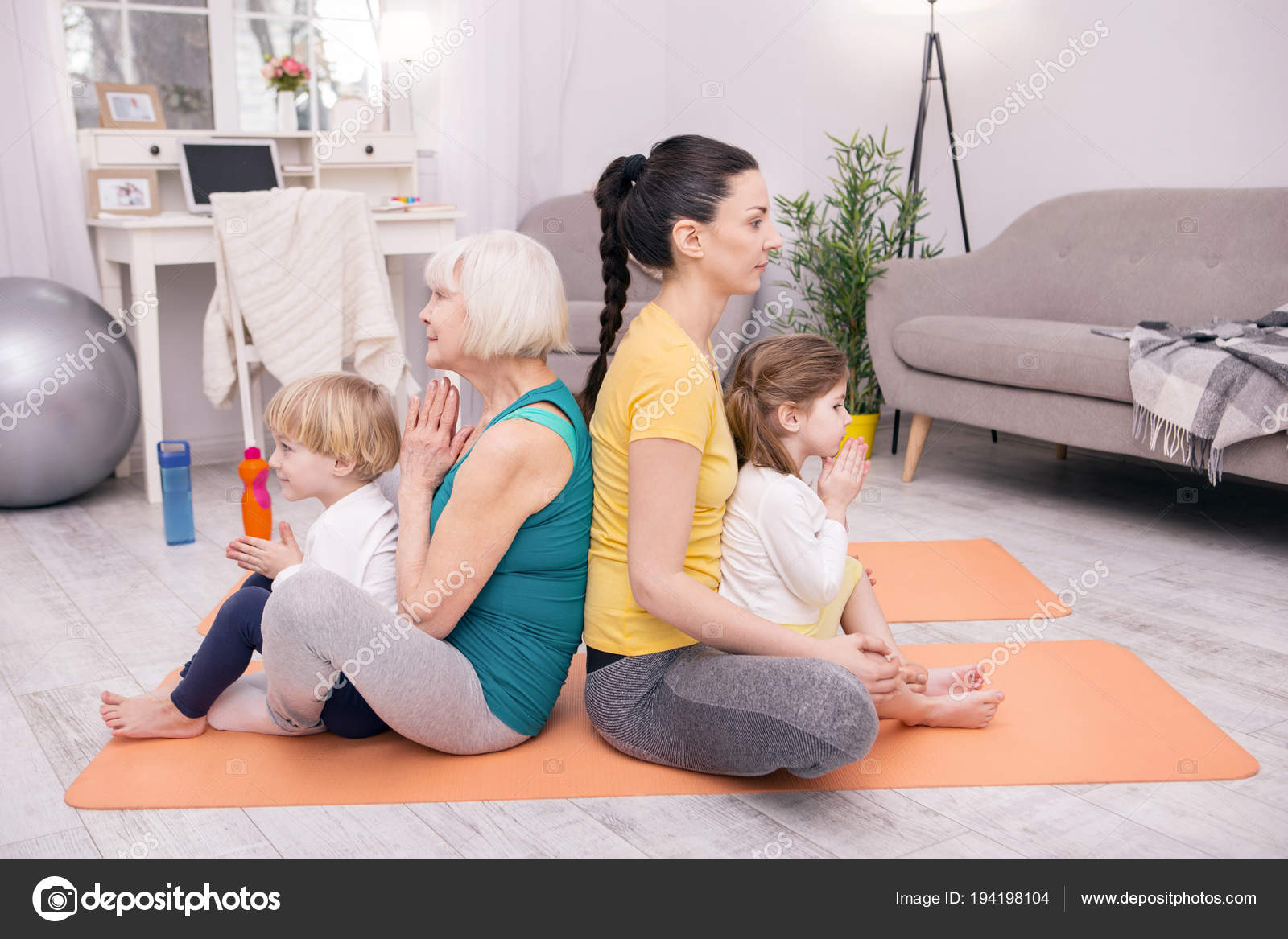 Content women and kids doing yoga — Stock Photo © yacobchuk1