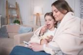 Fotografie Rád, matka a dcera v pohodlí domova