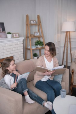 Caring mummy and daughter studying together