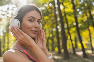 Cheerful lady enjoying the music in her ears