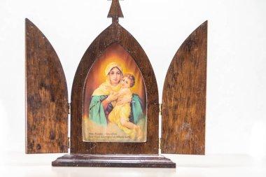 Symbolism and religiosity. Image of saint of the catholic church. Symbol of faith and hope. Christianity. Dolls representing Catholic saints. Souvenir. Tourism and religious commerce. Catholicism.