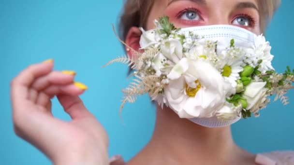 Face mask design with flowers. Portrait of beautiful woman with blue eyes, fashion make-up and mask