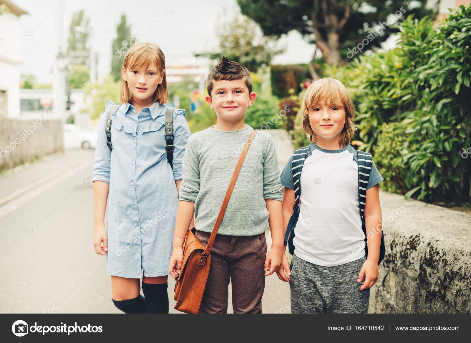 a8869751f7 Cute kids with backpacks walking back to school — Stock Photo ...
