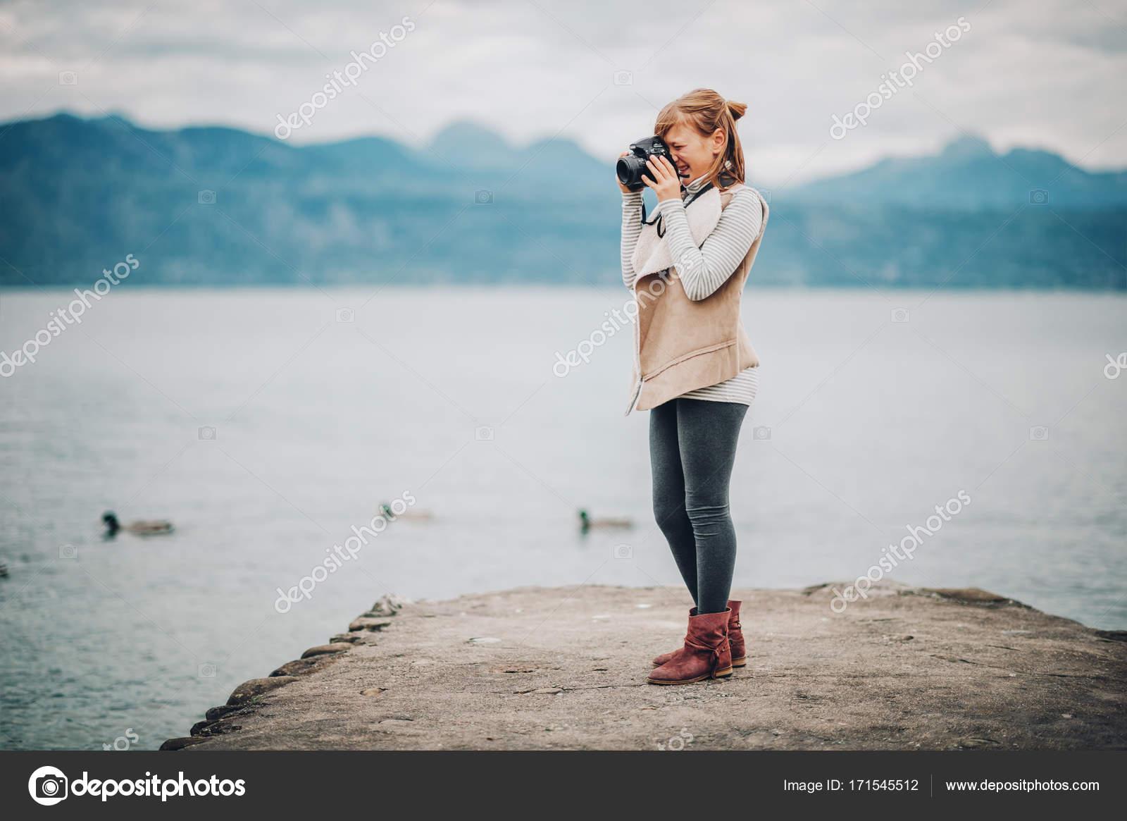 cute little preteen girl enjoying nice day on lake geneva taking rh depositphotos com