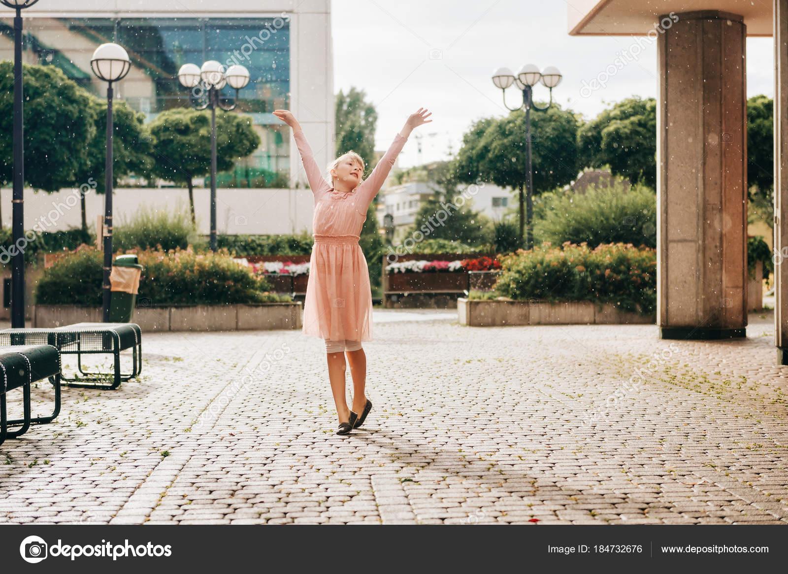 962e3b85b Beautiful Little Girl Dancing Rain Wearing Soft Ballerina Dress ...