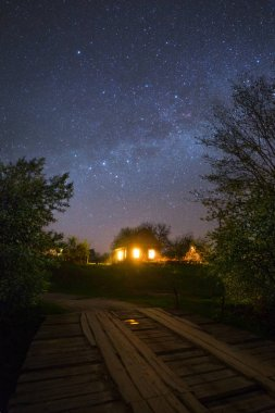 Stars Shining in sky at night over house