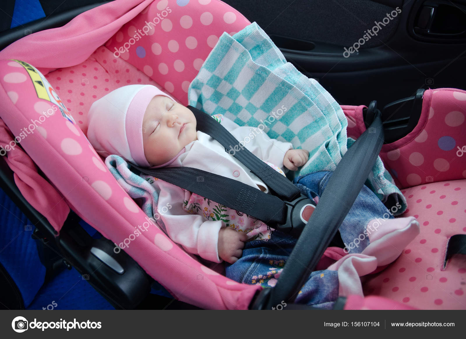 Newborn sleeping in car seat.Safety concept. Infant baby girl ...
