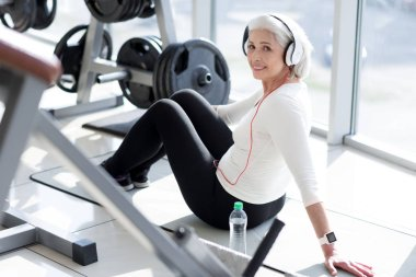 woman relaxing with music after workout.