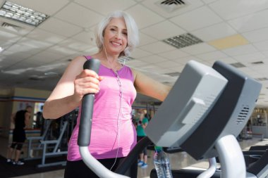 woman exercising on exercise bike