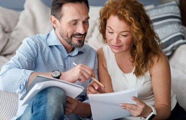 Middle-aged man and woman couple making notes