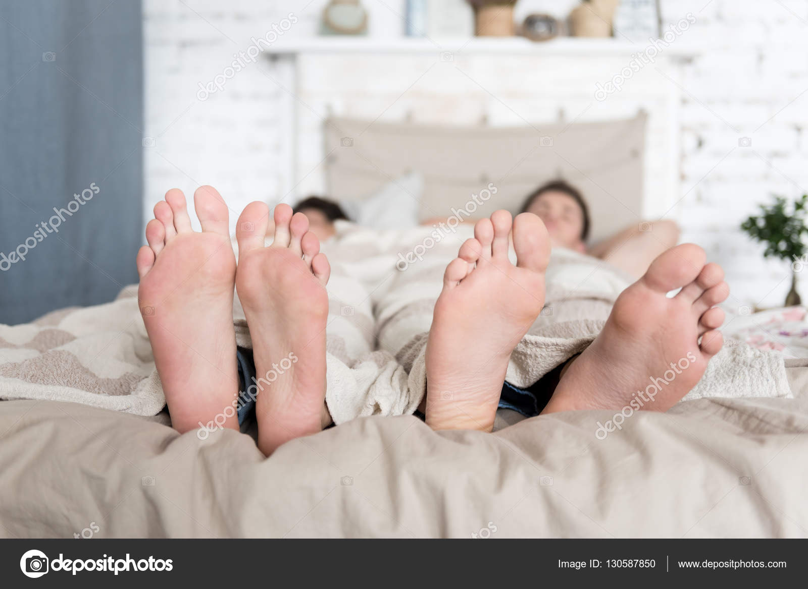 Gay A Letto.Gay Couple Feet Lying In Bed Stock Photo C Dmyrto Z 130587850