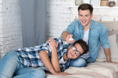 Happy homosexual couple relaxing together.