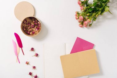 Several envelops being surrounded by flowers