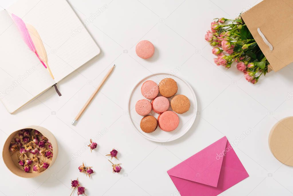 Flat lay of delicious macaroons lying on the plate