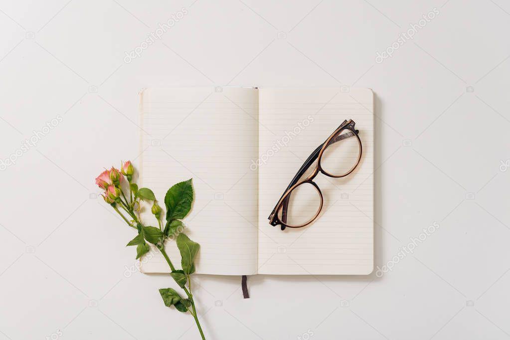 Eyeglasses lying on the open notebook