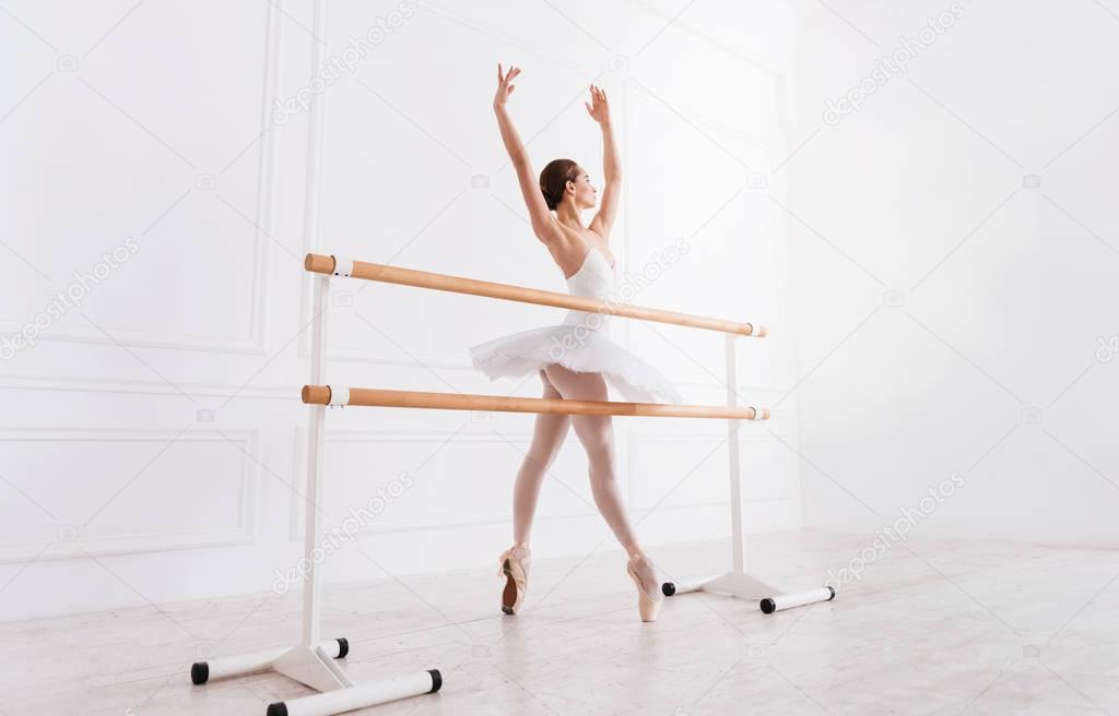 Pretty ballet dancer standing in fifth position