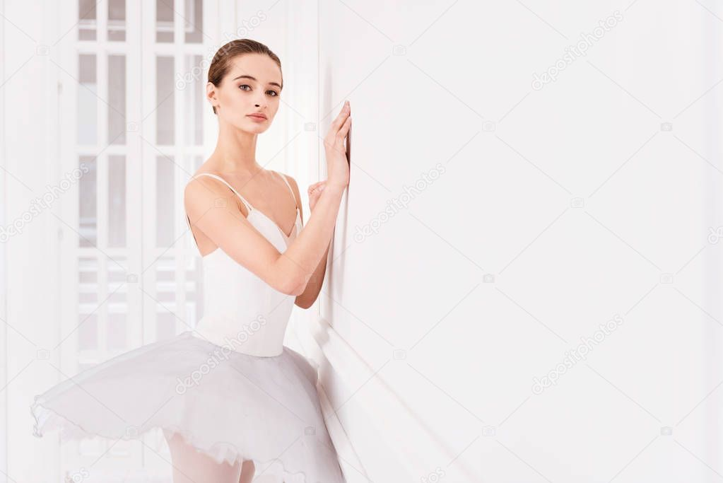 Beautiful ballet dancer looking at camera