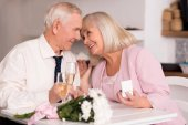 Fotografie Elderly love birds enjoying emotional moment