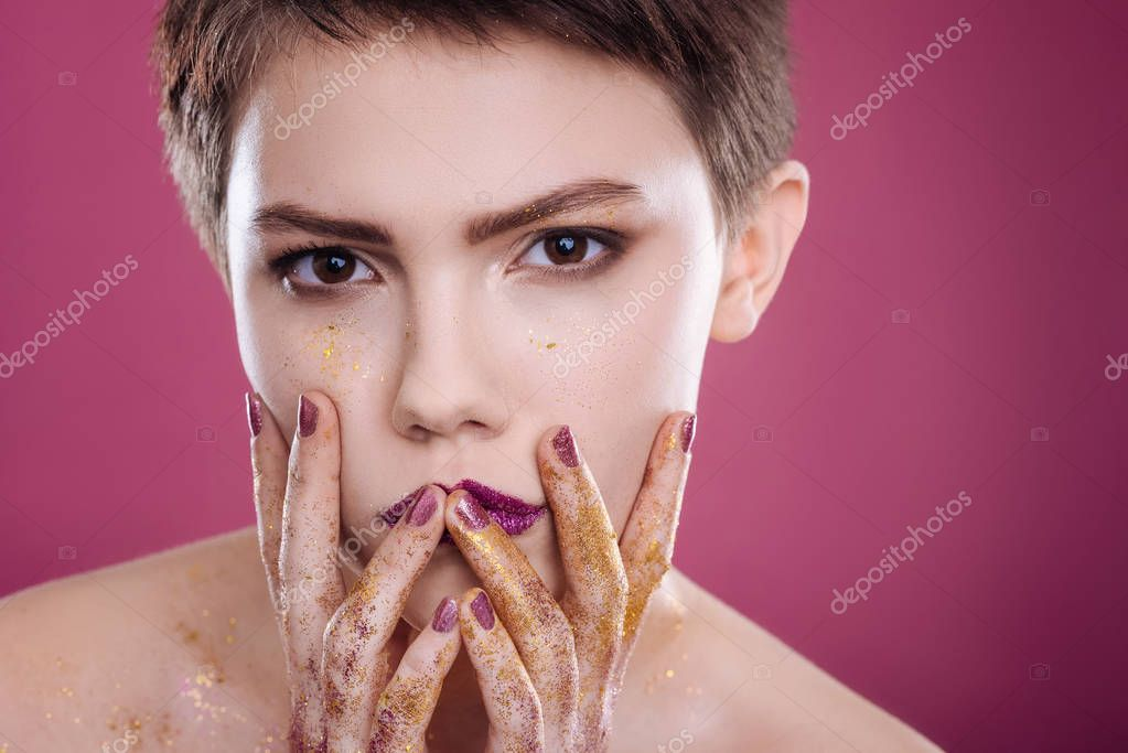 Professional model posing on pink background