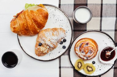 Refined French-style breakfast arranged on a wooden table