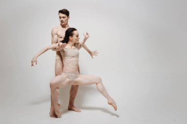 Charming creative couple performing