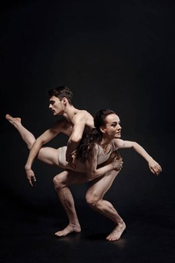Beautiful strong gymnasts performing together in the studio