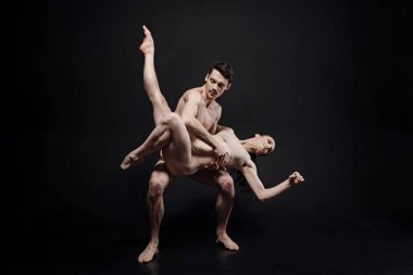 Graceful young dancers performing in the studio