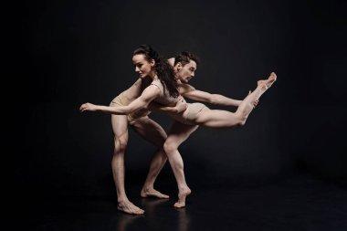 Proficient dancers performing together in the studio