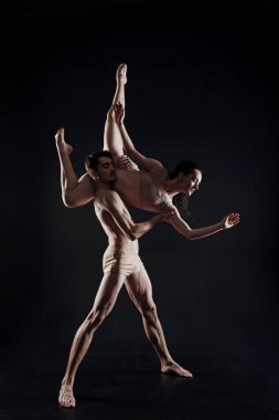 Professional young gymnasts dancing in the studio