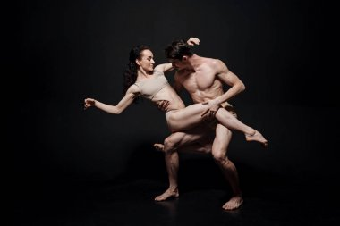 Delighted ballet dancers acting in the studio