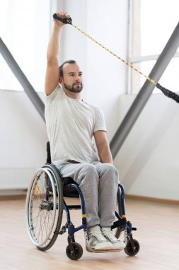 Confident young disabled working out in the gym