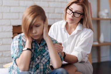 psychologist calming down patient