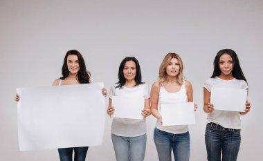 ladies demonstrating a big blank poster