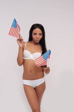 woman in underwear holding american flags