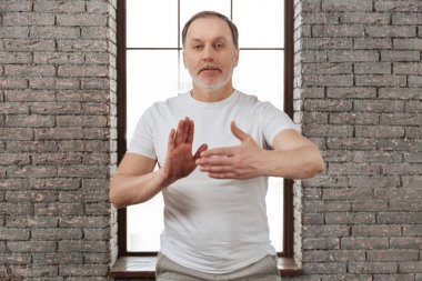 man holding hands in yoga position