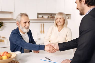 Successful broker meeting with elderly couple