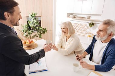 Cheerful notary having meeting with clients