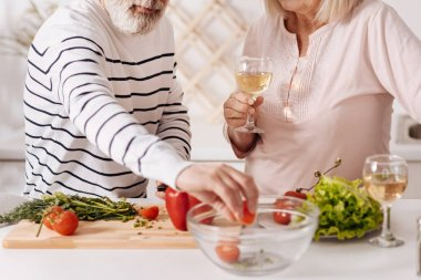 Skilled aged partners cooking together