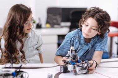 Inquisitive pupils exploring robot