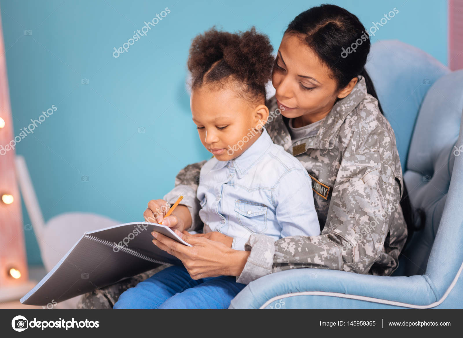 Mom and her child writing a letter together — Stock Photo