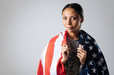 Charismatic brave lady wrapped in the flag