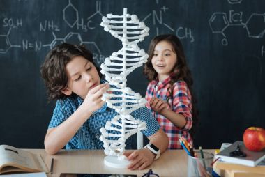 Amazed kids studying genetic code