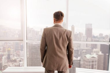 businessman standing near window