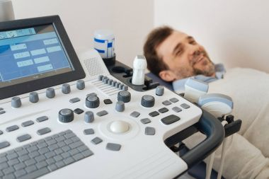 Enthusiastic patient waiting for an ultrasound procedure