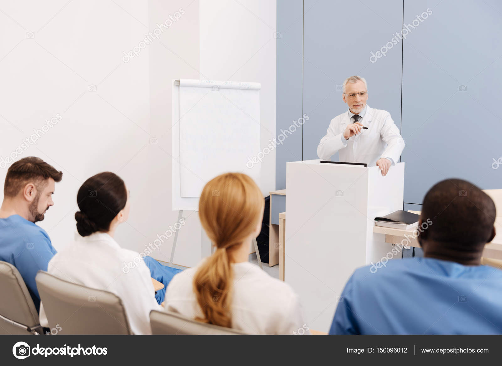 Experienced professor giving a lecture in the medical university ...