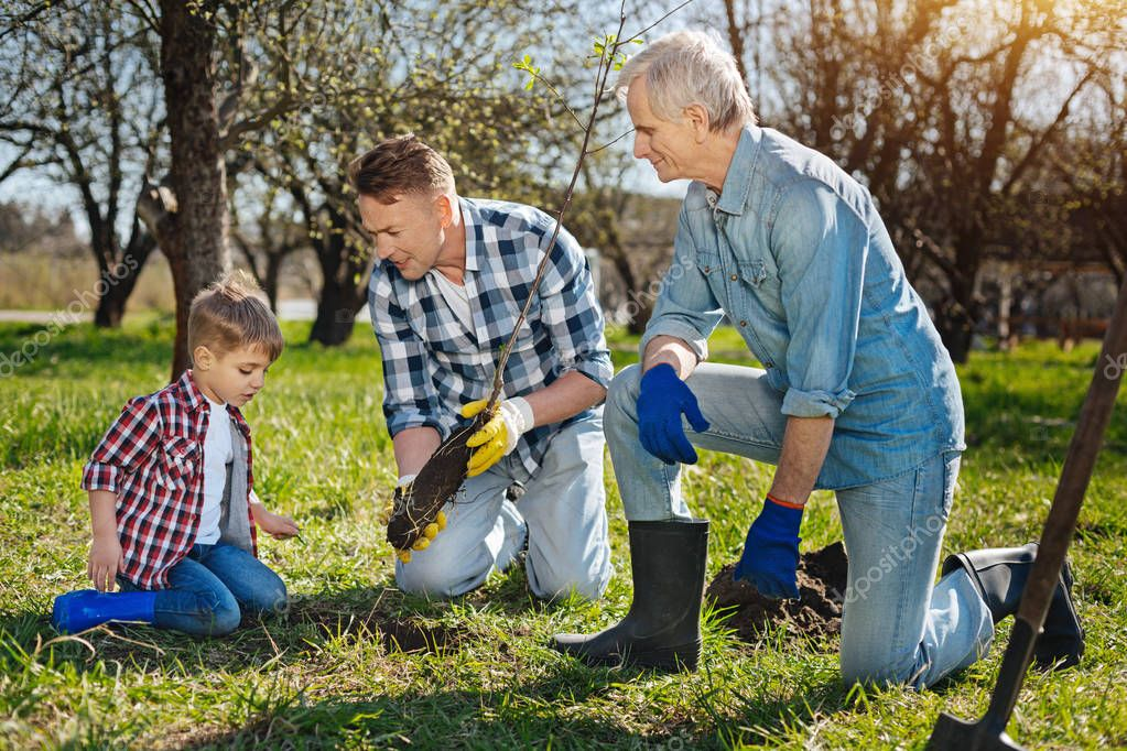 Older family members teaching kid how to care about nature