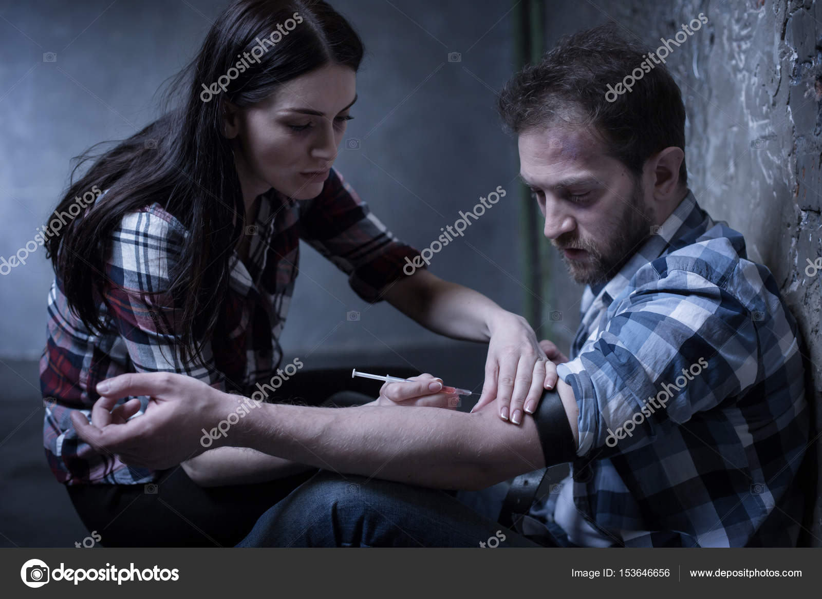 obsessed junkies making heroin injection indoors stock photo