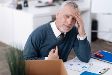 Upset office worker wrinkling his forehead