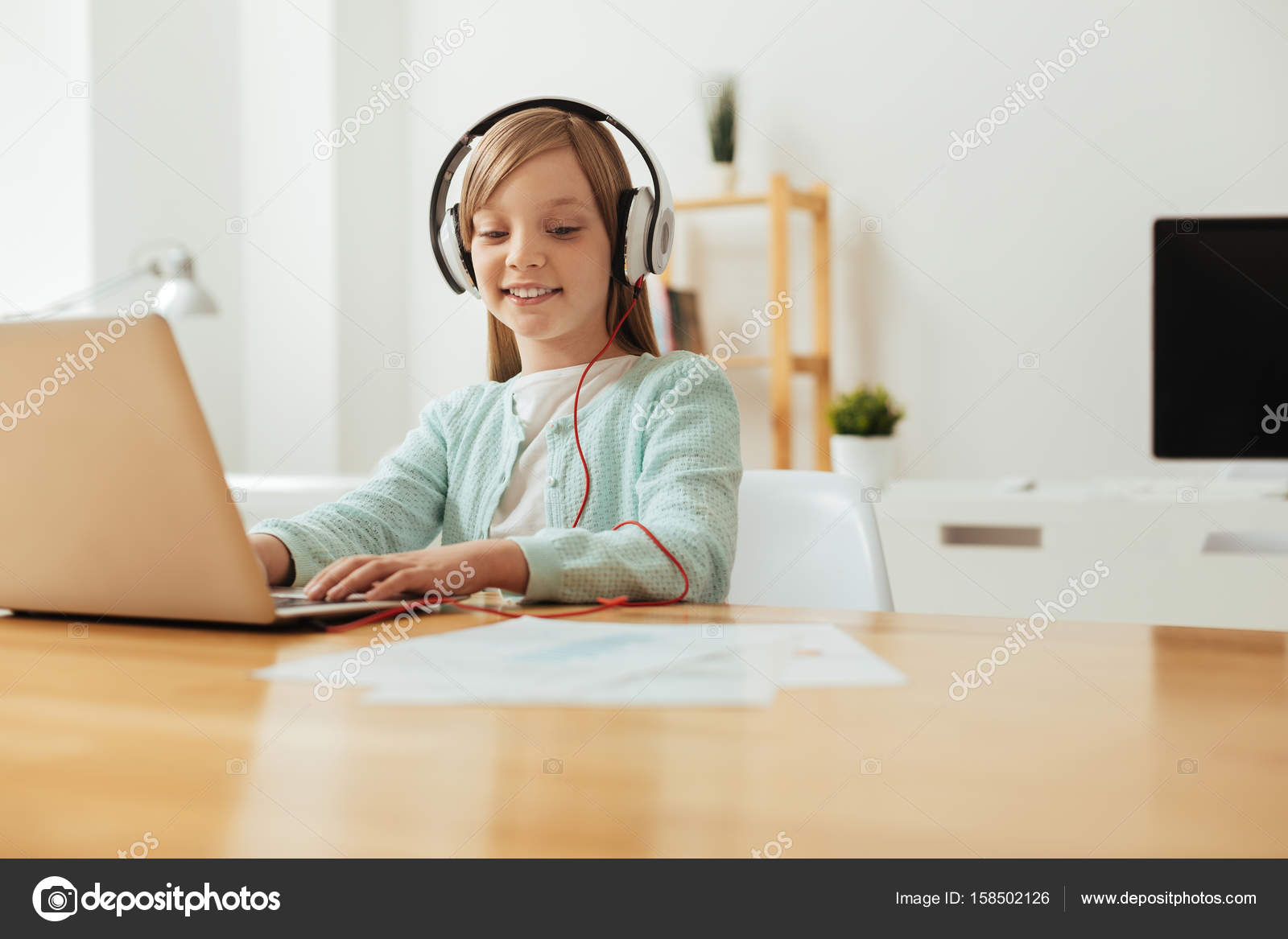 Person Listening To Music While Studying